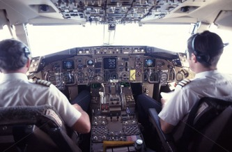 pilot-and-co-pilot-on-flight-deck-of-passenger-jet-airliner-a517td